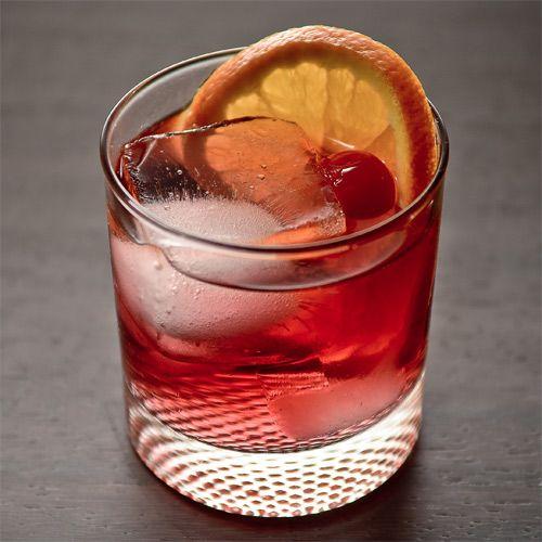 Forbidden Sour ~ 1 oz Pama Pomegranate Liquer, 1 oz Bourbon, 1 oz Lemon Juice, .5 oz Simple Syrup (one part sugar, one part water), Garnish: Orange Wheel, and Cherry