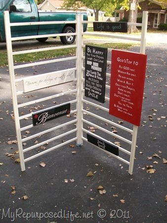 Crib Repurposed into Sign Display Piece. But I want to use it as a drying rack and linen display rack.  Looks like the two sides are attached with utility zip ties through holes at each end.