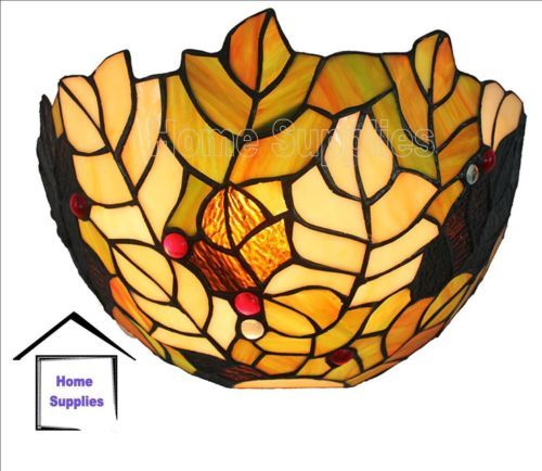 This wall light is hand-crafted using the same methods originated by Louis Comfort Tiffany. Each item is handcrafted by hundreds of individually cut stained glass pieces and each is a genuine heirloom quality work of art.