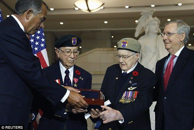 The real-life Inglorious Basterds: Rep Boehner (left) gives the Congressional Gold Medal t...