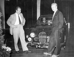 Mike Hawthorn at the launch of the Jaguar Mk 1 (2.4 Litre) in 1955. Mike later drove a 3.4 Litre both for racing and as a personal car in <a href=1958.php>1958</a> but died after a crash in it in January <a href=1959.php>1959</a>