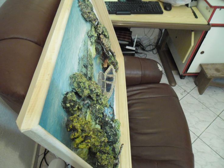 Top view of the 2 boats on a lake painting. Notice how much the boats come out of the frame.