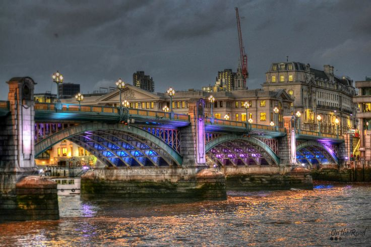 By the time my stroll on the Queen's Walk, in London, was over it was dark, so every single building around me lit up in beautiful colors. One of my favorite was Southwark Bridge. The actual bridge looked pretty dull, but once the lights were turned on it was just magical.