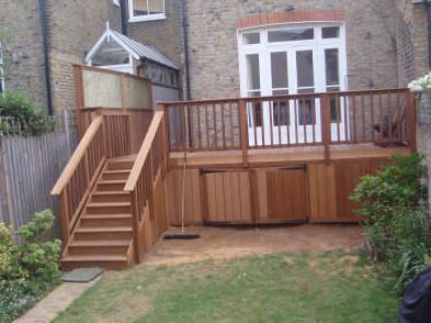Hardwood deck with storage. The broom is not just a theatrical prop. We do actually clean up after buiding our decks!
