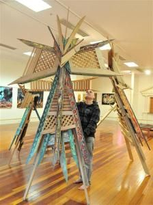 Riverton artist Chris Flavell with his Maori kite sculptures at the Dunedin Community Gallery. Photo by Linda Robertson.
