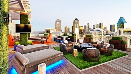 Stunning Rooftop Terrace with Deck Sofa Sets LCD TV and Wood Tile Floor