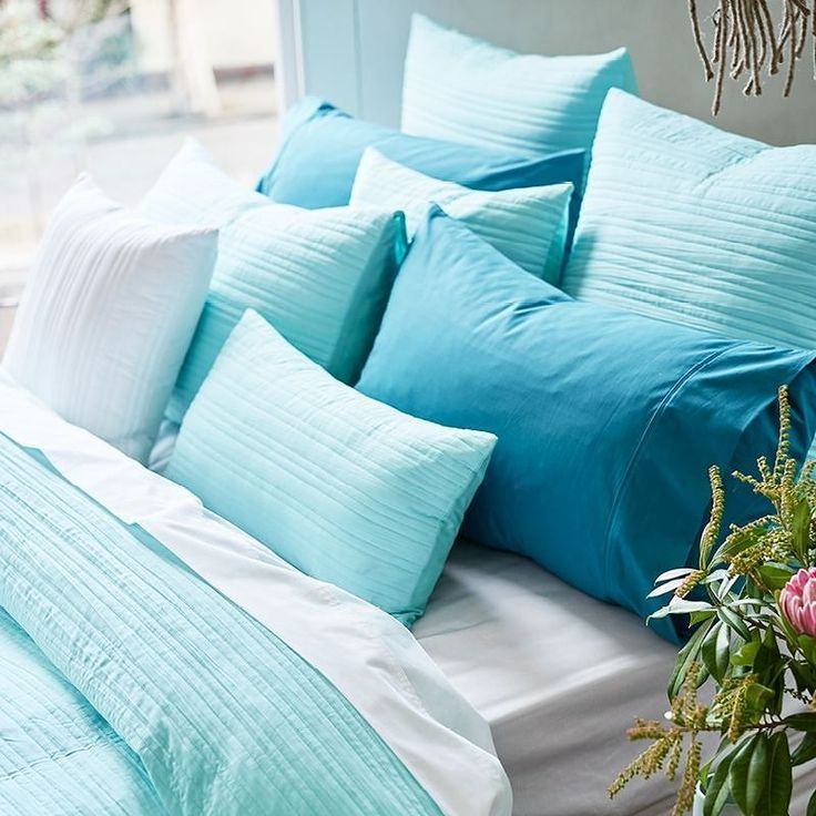 What could be more calming than this pile of Taya mint pillows?