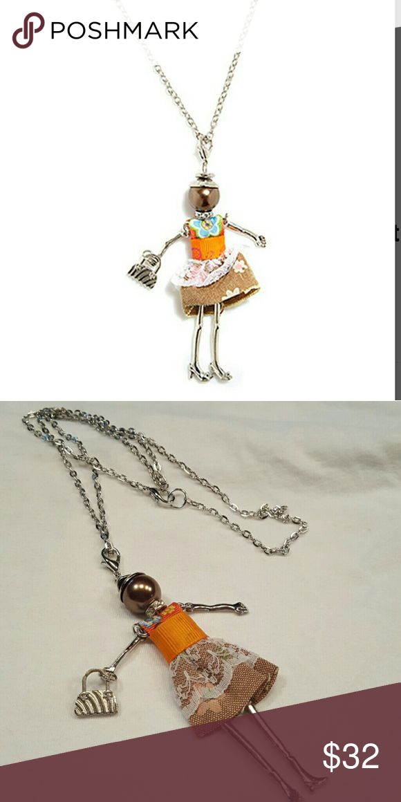 Orange & Silvertone Woman Pendant Necklace Unique and beautiful. This little lady dances on the end of a 28in silver plated necklace. Lobster clasp. Imported from Love Paris. Each one a little different. Jewelry Necklaces