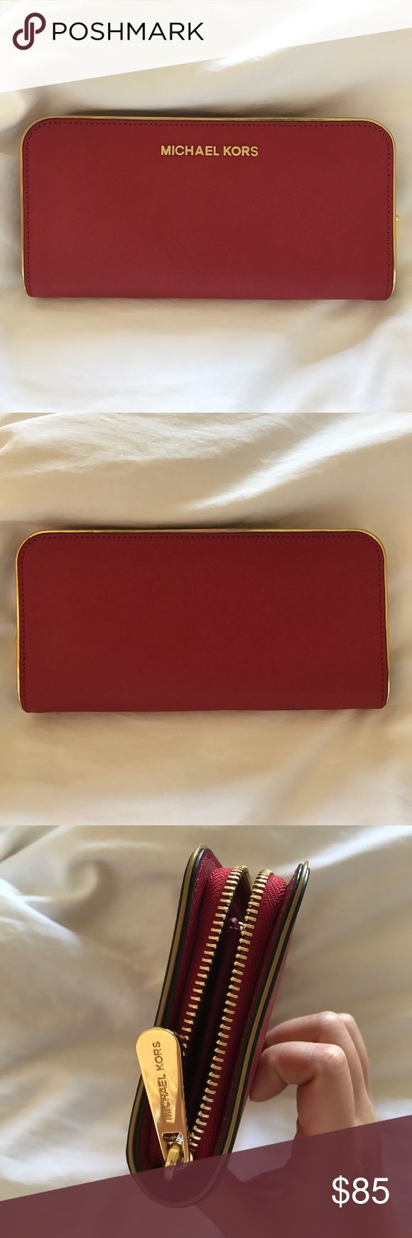 NWOT MICHAEL KORS CONTINENTAL WALLET IN RED A nwot Michael Kors continental wallet in red with gold metal!! 2 bill compartments, 8 card slots, and a zip inside for coins! Saffiano leather! MICHAEL Michael Kors Bags Wallets