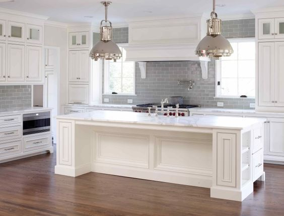 Furniture. Adorable White Kitchen Cabinets With Grey Glaze To Your Dream Kitchen. white wooden Kitchen Cabinet connected by double stainless steel pendant lamps over rectangle white wooden kitchen island