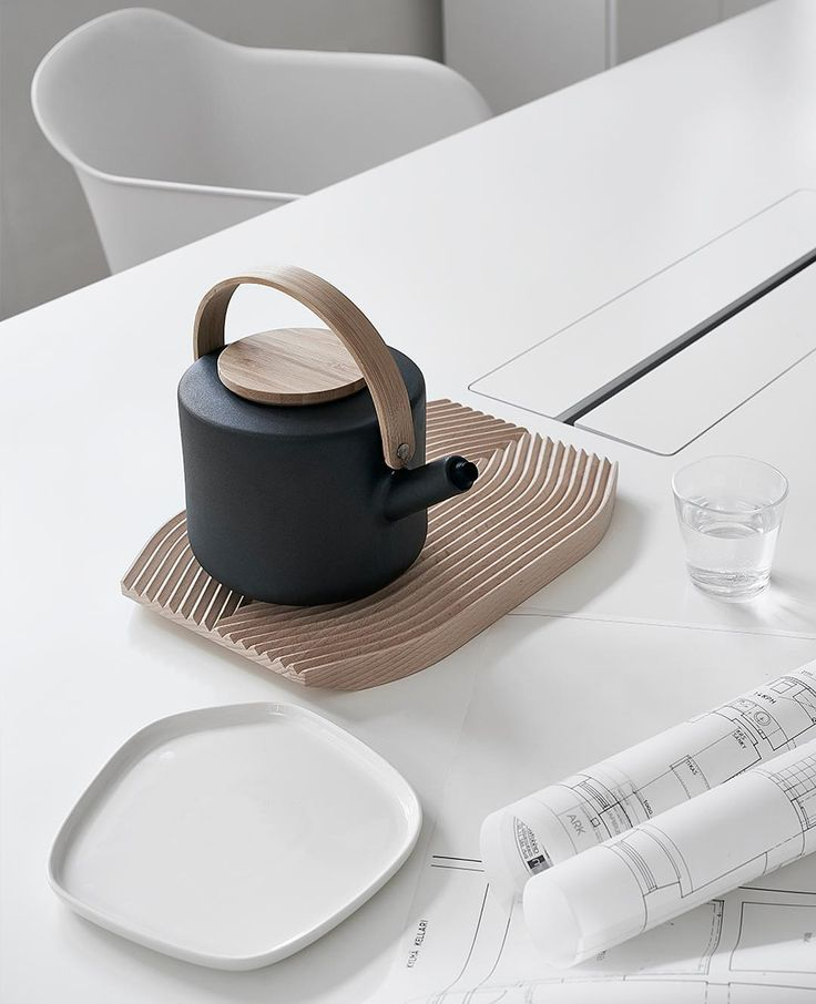 Stelton's black Theo teapot looks lovely on the 24/7 table from our own office…