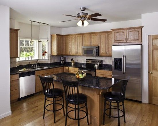 Black counters, Oak cabinets and Oak trim on Pinterest