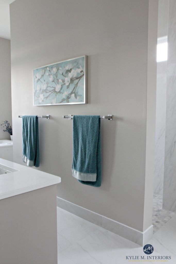 Bathroom with marble floor and shower with Benjamin Moore Balboa Mist, warm gray or greige paint colour. Kylie M Interiors E-decor services and consulting