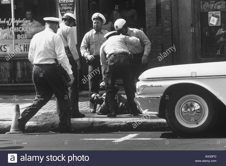 Download this stock image: Birmingham 1963 Ethel Witherspoon is wrestled to the ground and arrested by Birmingham police including chief Jamie Moore - A0G9FD from Alamy's library of millions of high resolution stock photos, illustrations and vectors.