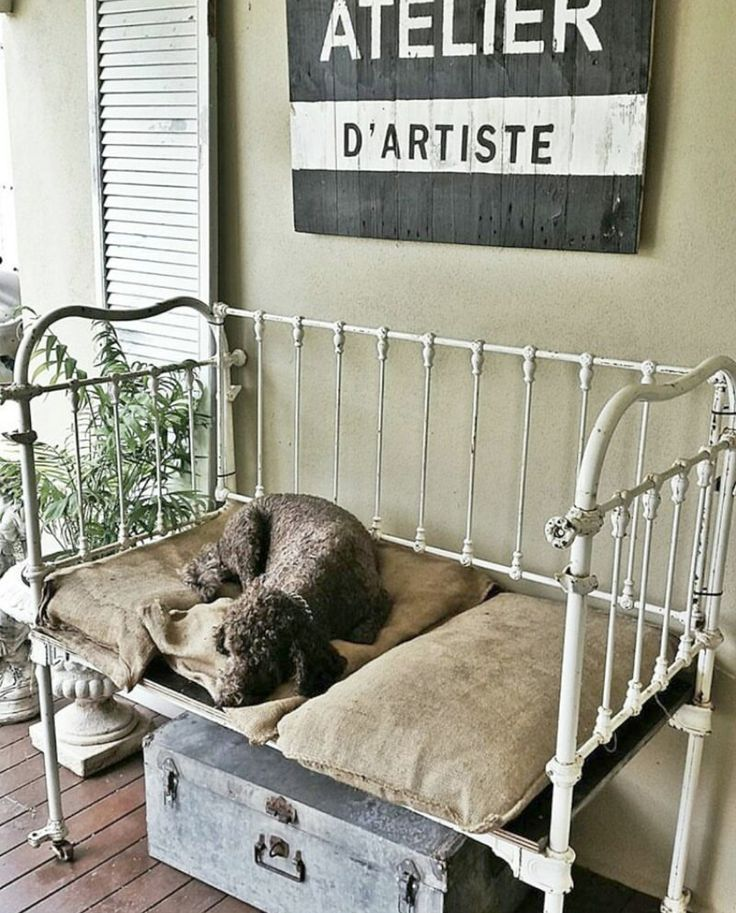 "A salvaged home tour. This antique ""cot"" was going to be a day bed until the dogs claimed it. Now it's a farmhouse dog bed."