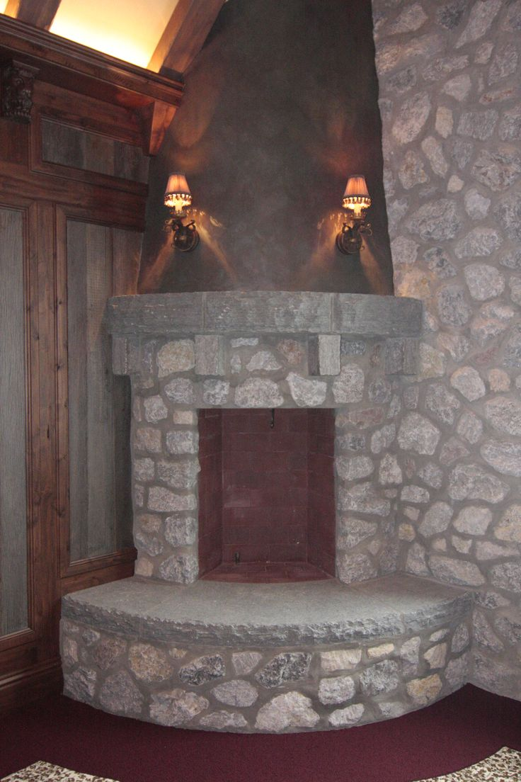 17 best images about stone fireplaces on pinterest for Corner fireplace stone
