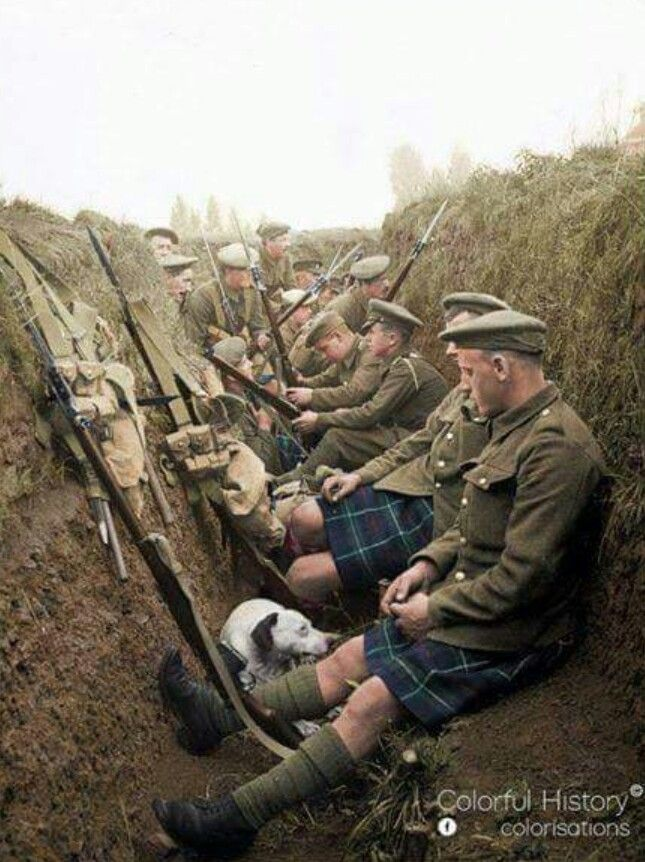Seaforth Highlanders and a dog in a shallow trench near La Gorgue, France, 1915. Trenches were shallow as it was thought they wouldn't be there for long.