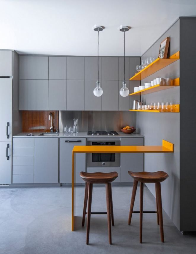 Grey kitchen, yellow shelves and dining table