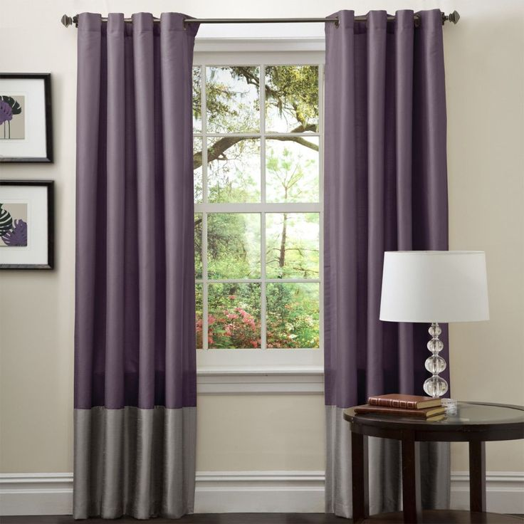 Add a subtle pop of color to your living room with these purple curtain panels from Lush Decor. This set of two panels is 84 inches long and made of patterned faux silk. With rod-pocket construction, these curtains feature trendy gray color blocking.