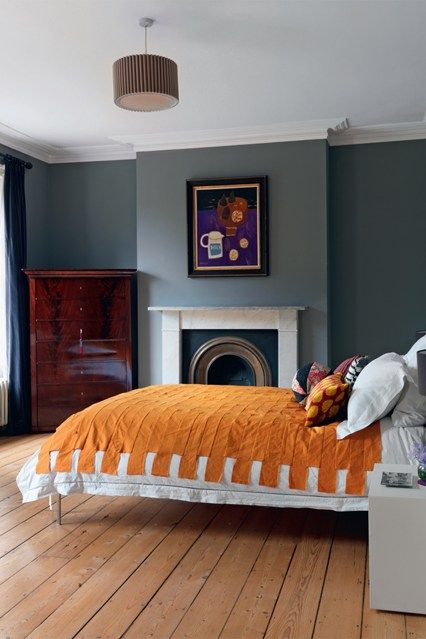 Orange and grey colour scheme - Bedroom Decorating & Design Ideas (houseandgarden.co.uk)- but I love this because of what the Brits do so incredibly well - update and appreciate!  Check out the modern bed, room colour and lighting - but that antique bureau is stunning and adds a bit of masculinity to the room.  Gorgeous!