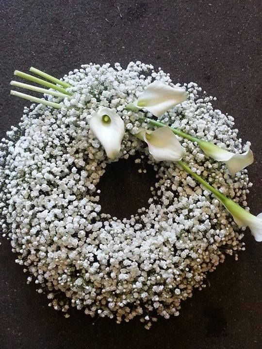 Beautiful Wreath for Wedding Ceremony. Baby's Breath is nice but the Cala Lilies add that special touch.