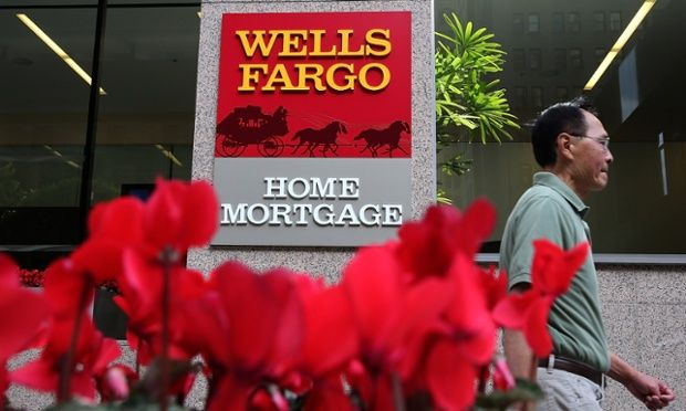 A pedestrian walks by a Wells Fargo home mortgage office in San Francisco, California.
