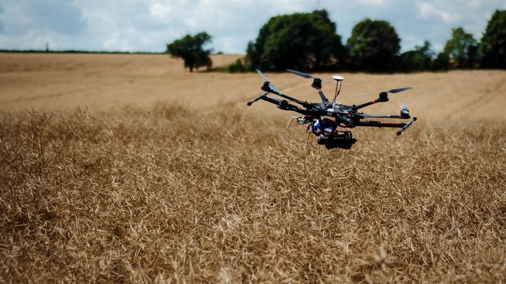 DJI S800 flying over crops. We use this for crop surveys and mapping