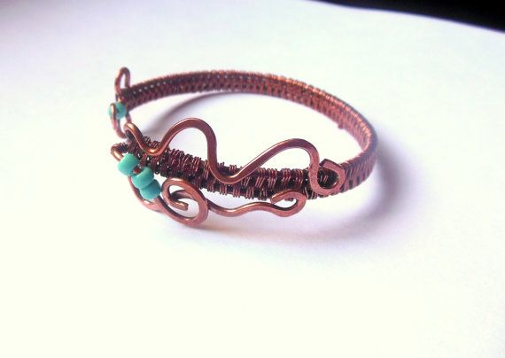Copper wire wrapped bracelet with glass seed by shamankailona