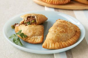 Savory Beef Empanadas Recipe - I'm thinking that some Spanish or Mexican rice and beans would go with this well plus a salad. I'm thinking of trying using salsa instead of Zesty Italian dressing to make the flavor more Latino. Have guacamole and sour cream on hand!