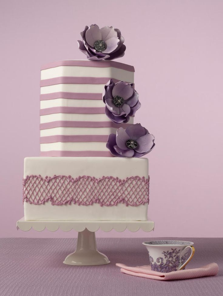 Think outside the box with your wedding cake design! Square cakes look sleek and modern, but you could even go for a hexagonal- or petal-shaped cake for a totally unique design.