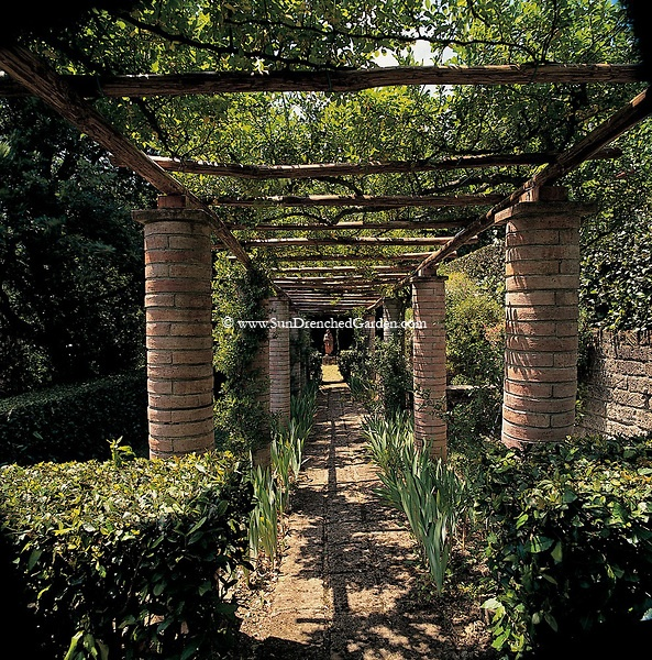 town/courtyard concept...from Rustic Tuscan Syle Pergola In Umbria, Italy made of pianelle, or curved bricks. These columns were made originally by the Romans and plastered to look like stone walls. Valle Pinciole in Umbria, Italy