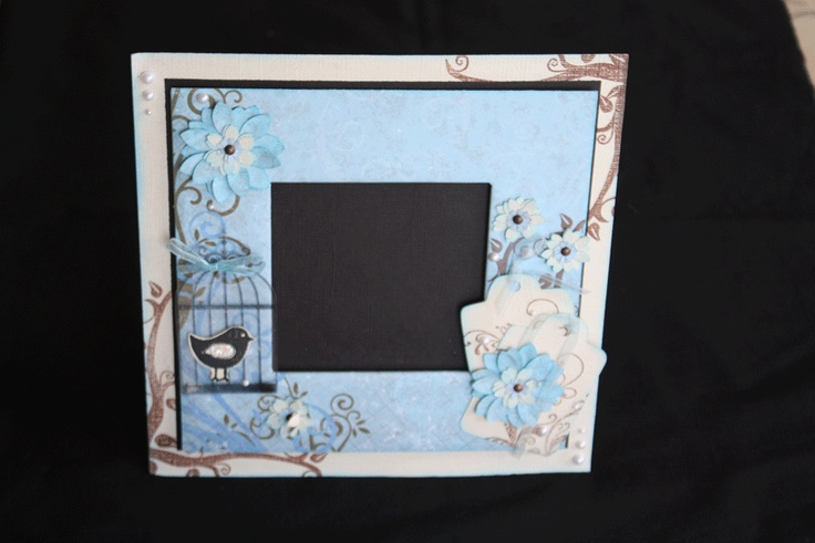 A 21x21cm frame that fits about a 10 or 11cm square photo. Looks beautiful in a dusty pink paper also.