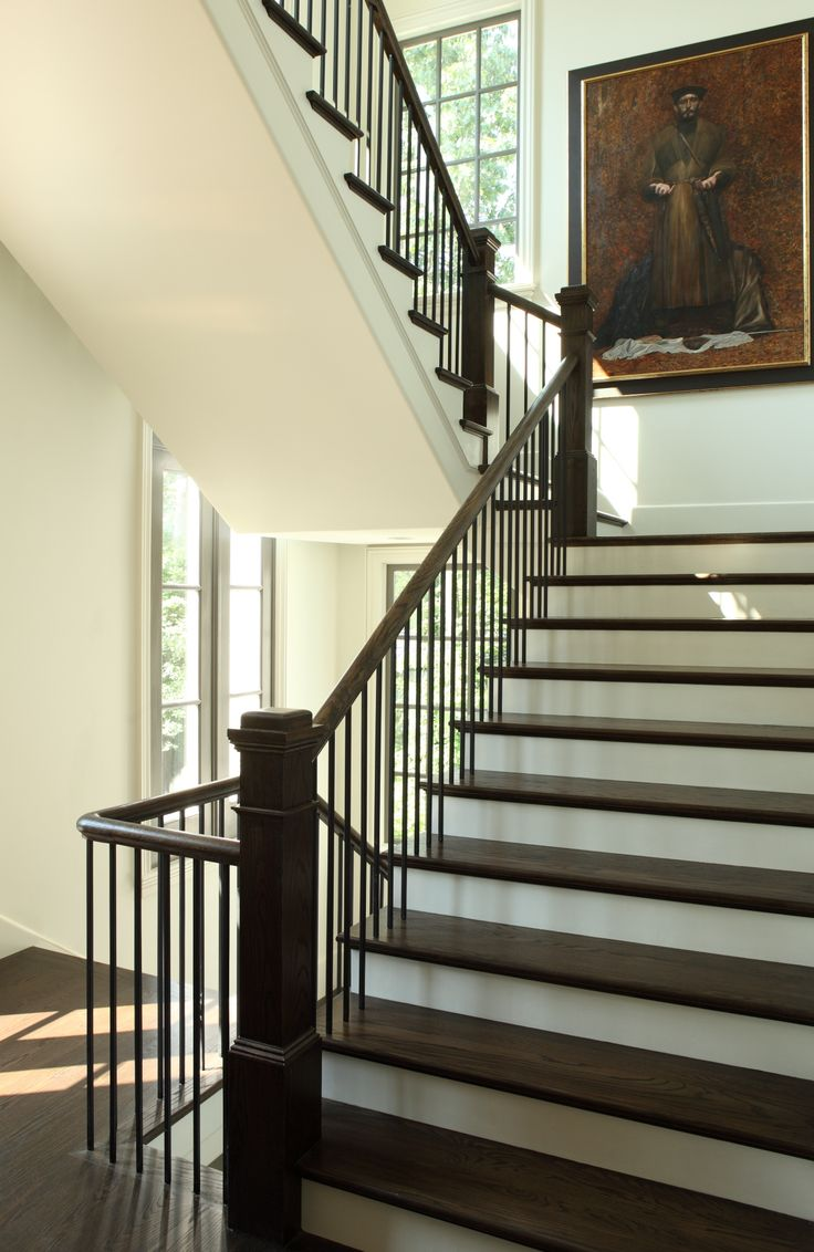 Light filled stairwell with fantastic art. Hedgewood custom home.