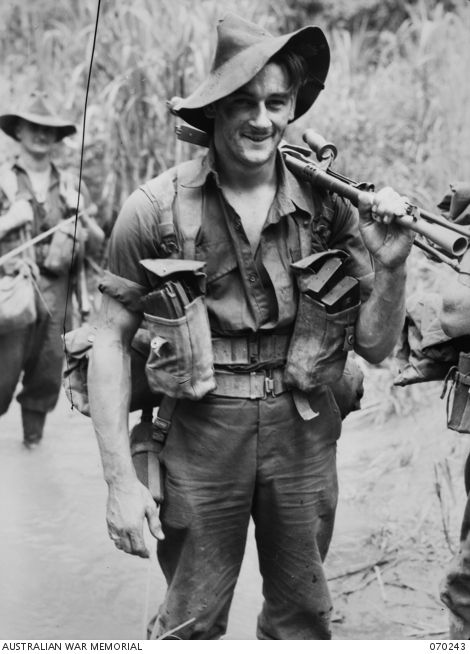 FARIA VALLEY, NEW GUINEA. 1944-02-09. SX18003 PRIVATE D. JONES OF THE 2/10TH INFANTRY BATTALION PICTURED CROSSING THE FARIA RIVER.