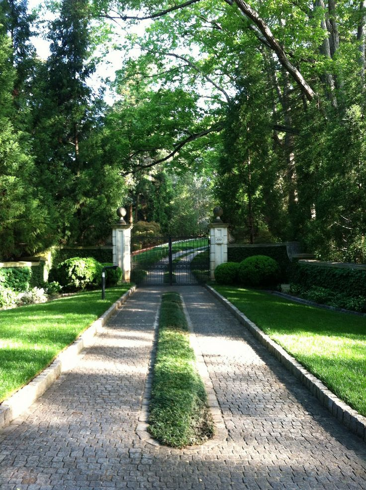 Lovely entrance and paver driveway with grassy strip for Sloped driveway options