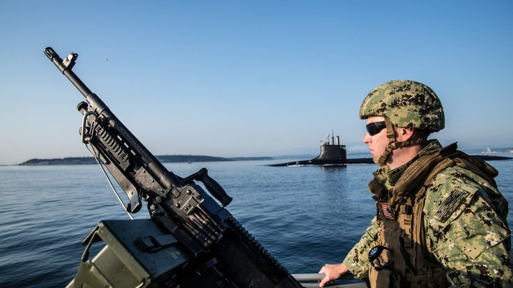 Hospital Corpsman 1st Class James Chidester, crewman gunner assigned to Coastal Riverine Squadron (CRS) 11, High Value Unit (HVU) Pacific Northwest, stands forward lookout onboard a 34-foot Sea Arc patrol boat Aug. 28, 2017, as it escorts the Seawolf-class fast-attack submarine USS Connecticut (SSN 22) during its transit home to Naval Base Kitsap-Bremerton, Wash. (Chief Boatswain's Mate Nelson Doromal/Navy)