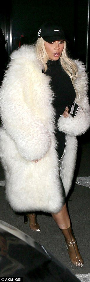 Not so happy Valentines? Kim stepped out in her Yeezy boots and the white fur over a black body-con that's formed the basis of her look this weekend in the Big Apple while her husband wore his hoodie up