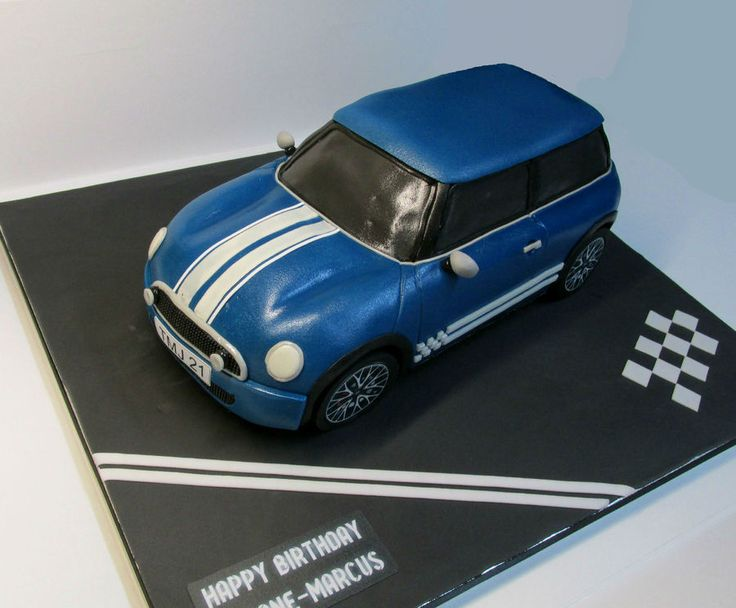 Mini Cooper Hatchback.  Car sits on a raised cake board... only the wheels are touching the main cake board.