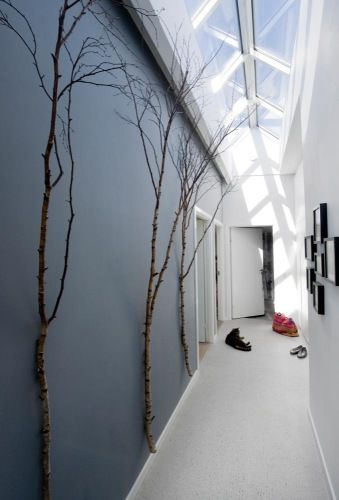 I chose this image because this space replicates a feeling of a winter wonderland, without the cold. The color scheme of dark and light and the particular angle at which the natural light is entering the space helps to achieve this feeling. The tree branches included as art bring texture and visual interest to the space, without being overbearing.