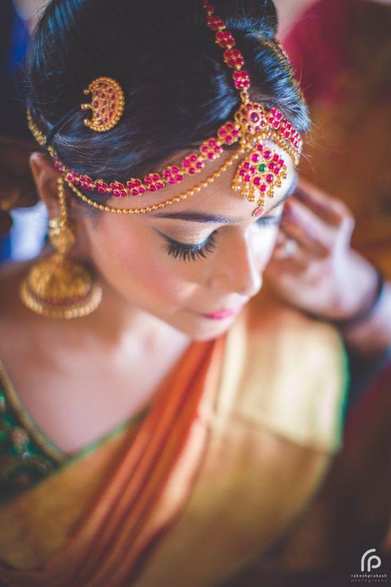 Traditional Southern Indian bride wearing bridal silk saree, jewellery and hairstyle. Bridal photoshoot. Temple jewelry. Jhumkis. Silk Kanchivaram sari. Braid with fresh flowers. Tamil bride. Telugu bride. Kannada bride. Hindu bride. Malayalee bride. Indian Bridal Makeup. Indian Bridal Fashion.