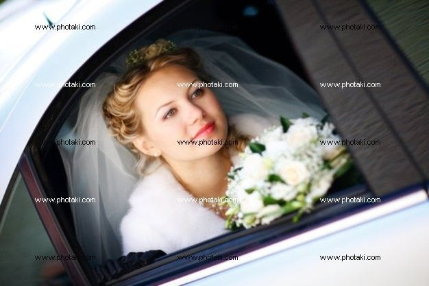 http://www.photaki.com/picture-portrait-of-the-bride-in-the-wedding-car_1125601.htm