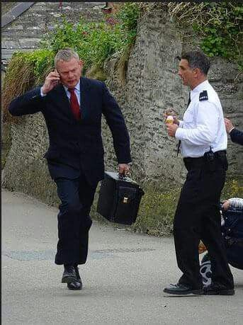 Martin Clunes & John Marquez filming Doc Martin, Series 7, in Port Isaac, Cornwall. May 2015