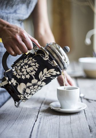 """""""Coffee Coats are stylish French press covers designed to keep your coffee (or Tea) warm and insulated. Each cozy is lined with a heat-retaining fabric and filled with a cotton insulator."""""""