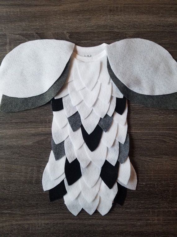 *** Due to the possible impact of Hurricane Matthew on our area, anyone needing costumes early should place orders now because shipping may be delayed a few days.  Your little owl will be a hoot in this Harry Potter inspired Hedwig costume. Available in a short or long sleeve onesie. Plain back. Costumes generally ship out within 1 week.