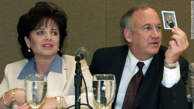 Patsy and John Ramsey show a picture of their daughter JonBenet Ramsey during a May 2000 press conference in Atlanta.