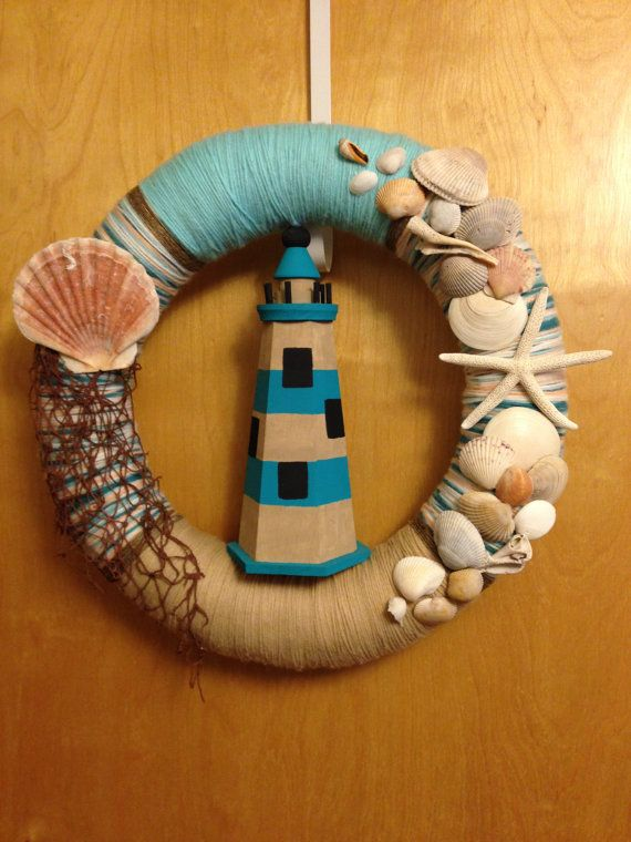 Beach Inspired, Nautical 16 inch yarn wreath with Lighthouse, Seashells and Starfish on Etsy, $40.00