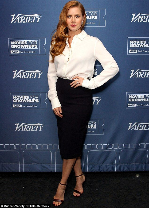 Simple, but effective: Amy Adams turned heads in a shirt and skirt at a showing of her fil...