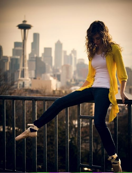 I have a passionate need for that yellow thing. Even better that she's wearing pointe shoes.