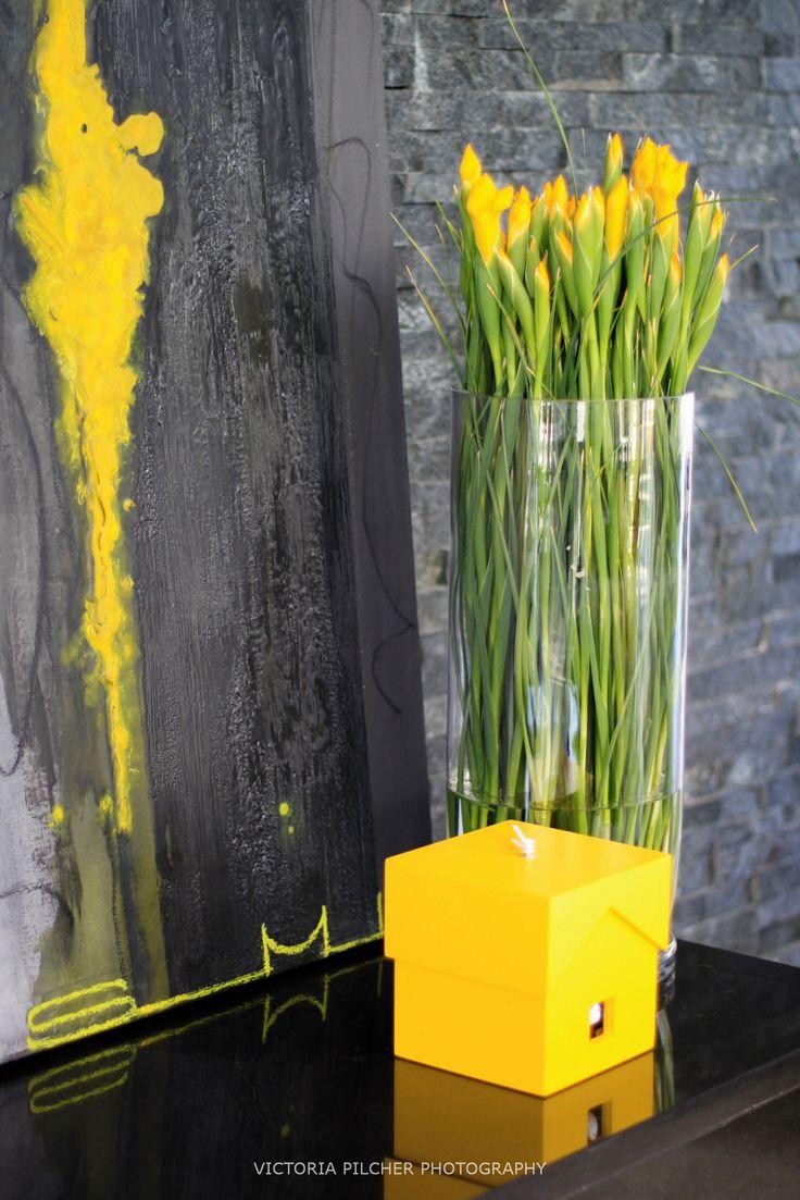 Details. Yellow flowers and cuckoo clock.   House Ber - Nico van der Meulen Architects