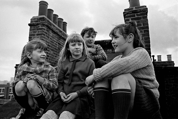 Children gossiping on the roof of their tenement block, Wandsworth | Nick Hedges 1969